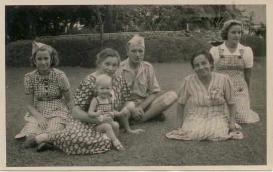 Family photo taken on Java during the occupation. Dee Kiesling on the right in a bibbed gingham dress.